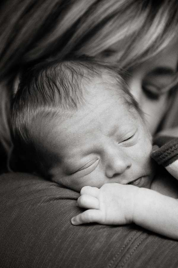 newborn boy relaxing in mama's arms