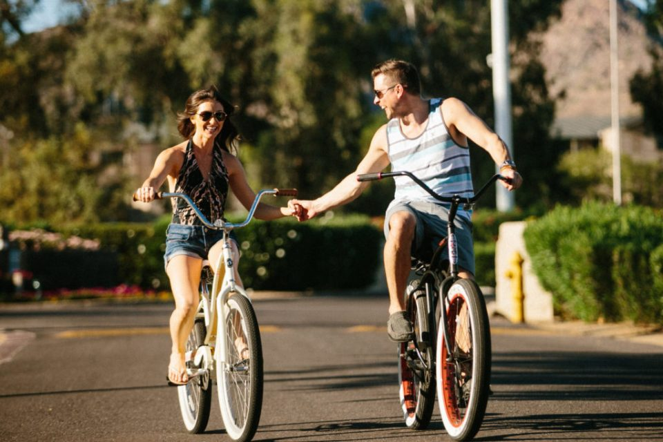 melissa and keith phoenix photographers couple riding a bike in neighborhood sunset couples photography