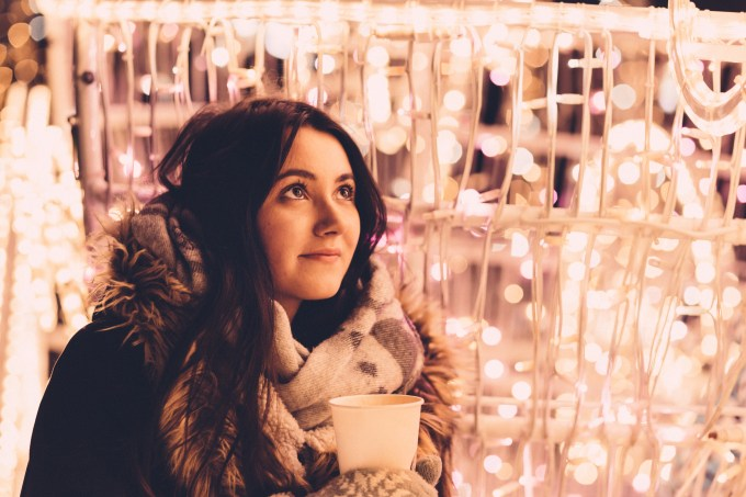 christmas_lights_and_girl_holding_coffee