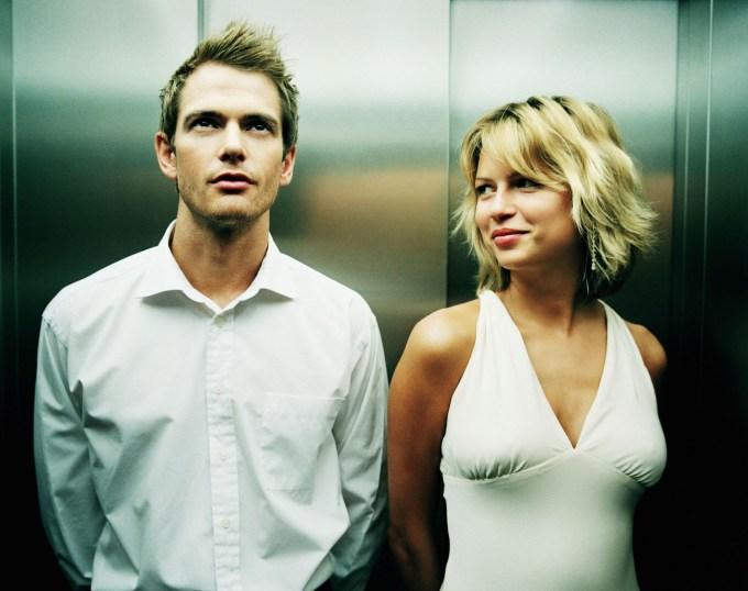 couple-flirting-sex-in-elevator