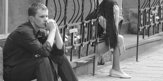 couple-sitting-away-from-each-other-crop