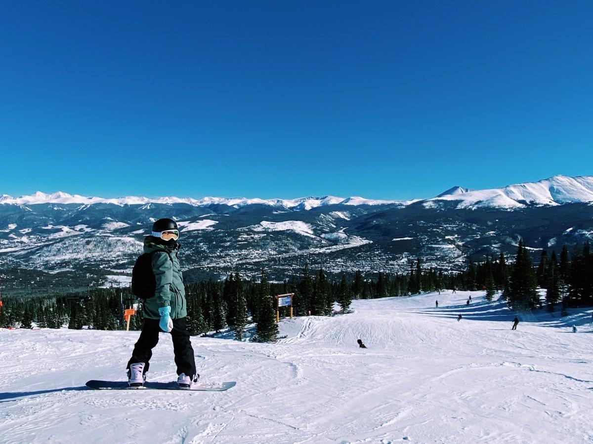 snowboarder with mountains at Breckenridge Ski Resort Colorado