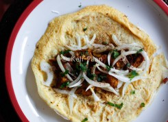 Add the filling over the egg.. along with the diced onions. chopped mint chaat masala..