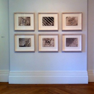 Jananne al-Ani, top l-r: 'Aerial II, VI, II', bottom l-r: Aerial I, IV, V', production stills from the film 'Shadow Sites II', 2011, digital pigment prints, photography by Adrian Warren, in 'My Sister Who Travels', at Mosaic Rooms, London. Photo credit Kelise Franclemont.