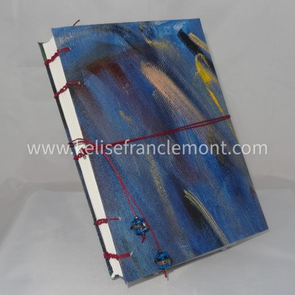 handsewn journal, exposed binding, abstract, blues, maroon, yellow; burgundy red cord closure with beads