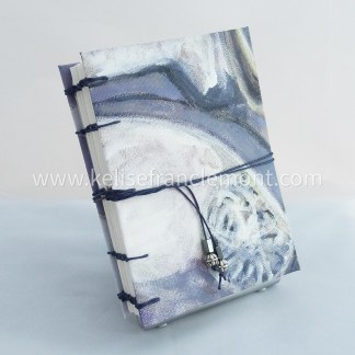 handsewn journal, exposed stitched binding, abstract, still life, purples, greys, whites; dark blue cord closure with beads