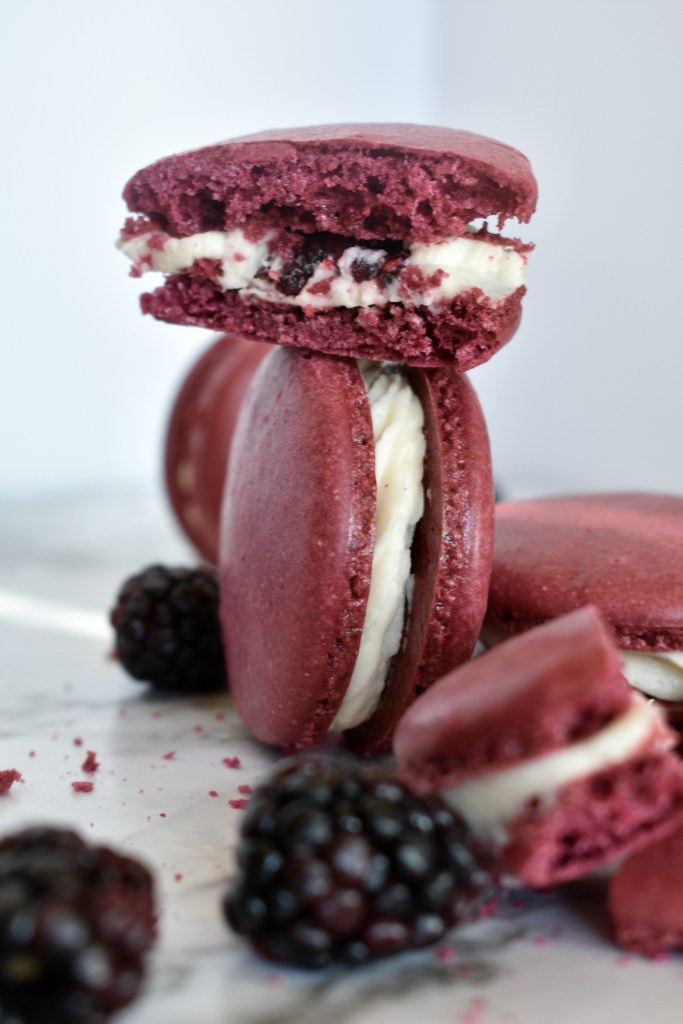 White Chocolate & Blackberry Macarons | These chocolate blackberry macarons are to die for! The sweetness of the white chocolate and the tartness of the blackberry is a match made in heaven! | https://butterysweet.com/macarons/white-chocolate-blackberry-macarons