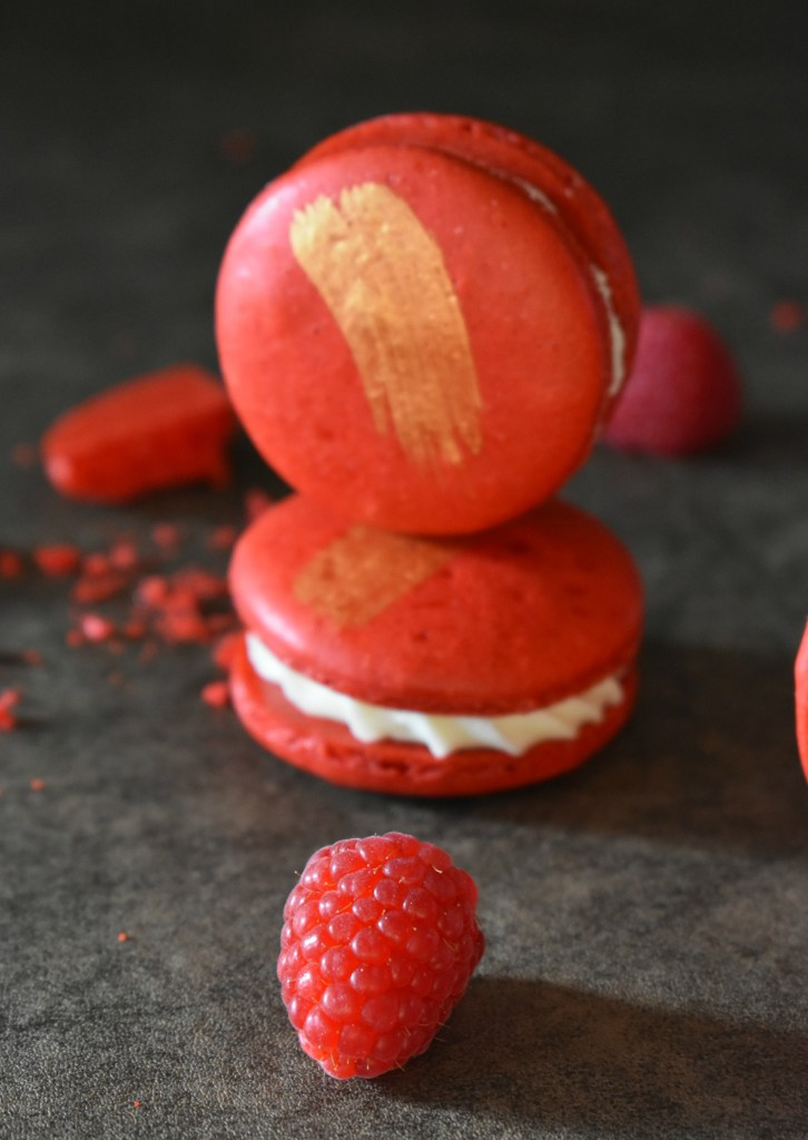 Incredible White Chocolate and Raspberry Macarons | These white chocolate raspberry macarons are simply incredible. From their perfect crisp red shell, to the creamy white chocolate ganache filling. | https://butterysweet.com/macarons/incredible-white-chocolate-&-raspberry-macarons