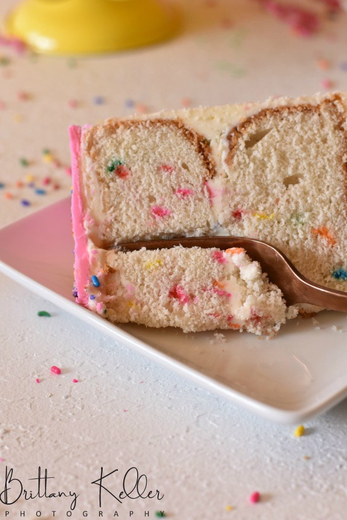 Ultimate Funfetti Cake Recipe| This homemade funfetti cake recipe is so fun and yummy! Super moist and fluffy white cake mixed with the fun colors of sprinkles and you have the ultimate birthday cake!| https://butterysweet.com/blog/ultimate-funfetti-cake-recipe