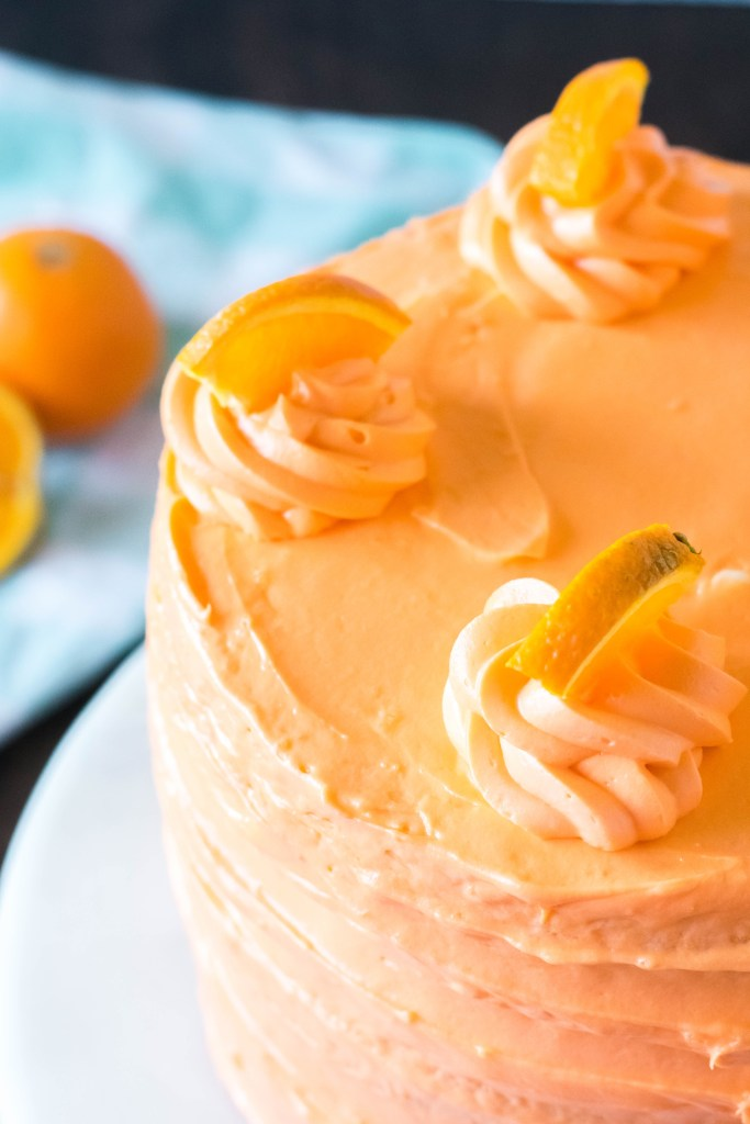 Orange Dreamsicle Cake| This Orange Dreamsicle cake is what dreams are made of. Simple white cake recipe infused with orange flavor and a fluffy orange cream filling  to die for!| https://butterysweet.com/blog/orange-dreamsicle-cake