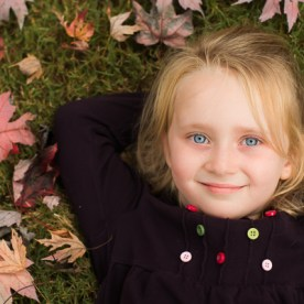 Girl in fall leaves | Kelley K Photography