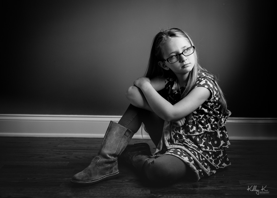 Black and white image of girl in directional window light