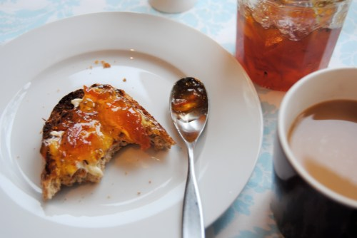 bitten toast with marmalade and coffee