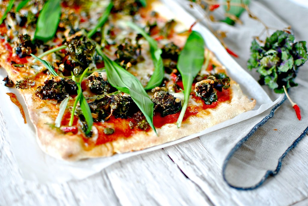 wild garlic pizza with kale tops , capers and chilli by food to glow