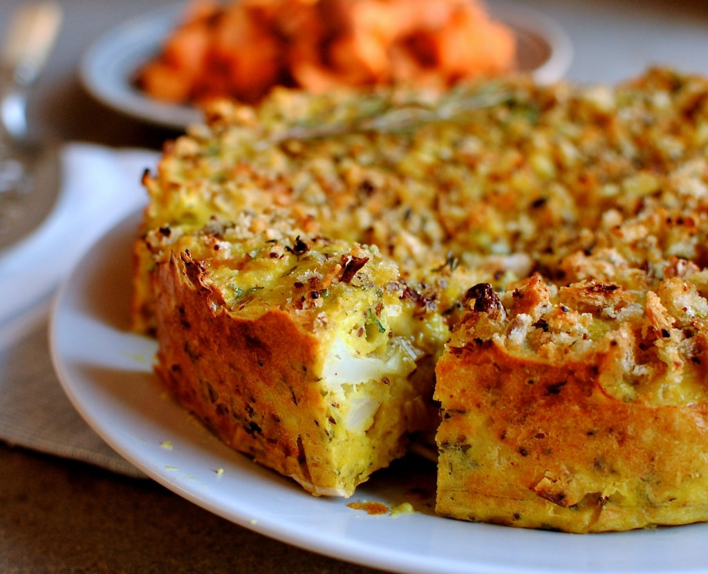 Caulflower Cheese is such a family favourite. that we thought it would be fun to take most of the elements of this yummy dish and make it into a cuttable cake! This is an easy recipe to make for the festive table that vegetarians and non-vegetarians alike will enjoy.