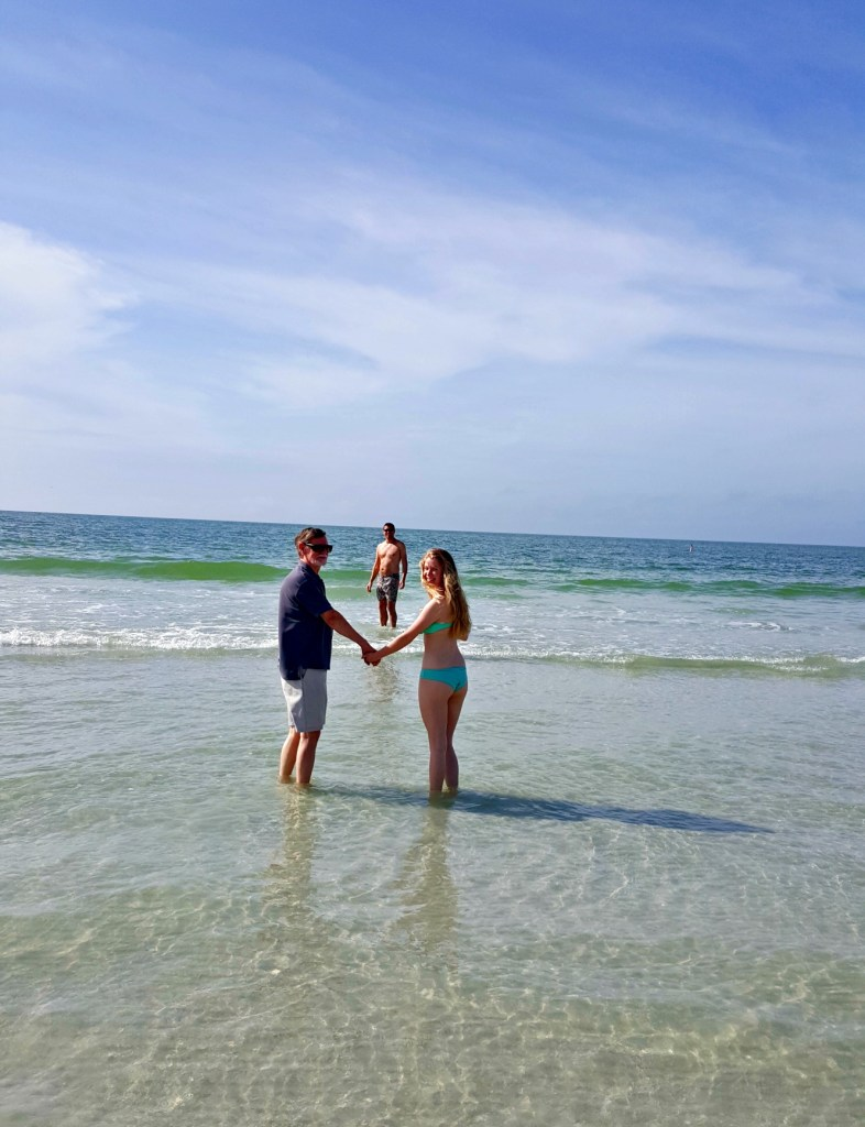 My Dad, daughter Rachel and husband Andrew on the beach behind my sister Julie's house on Sunset Beach, Treasure Island, Florida. Do I want to go back to the UK on Friday? Er, no.