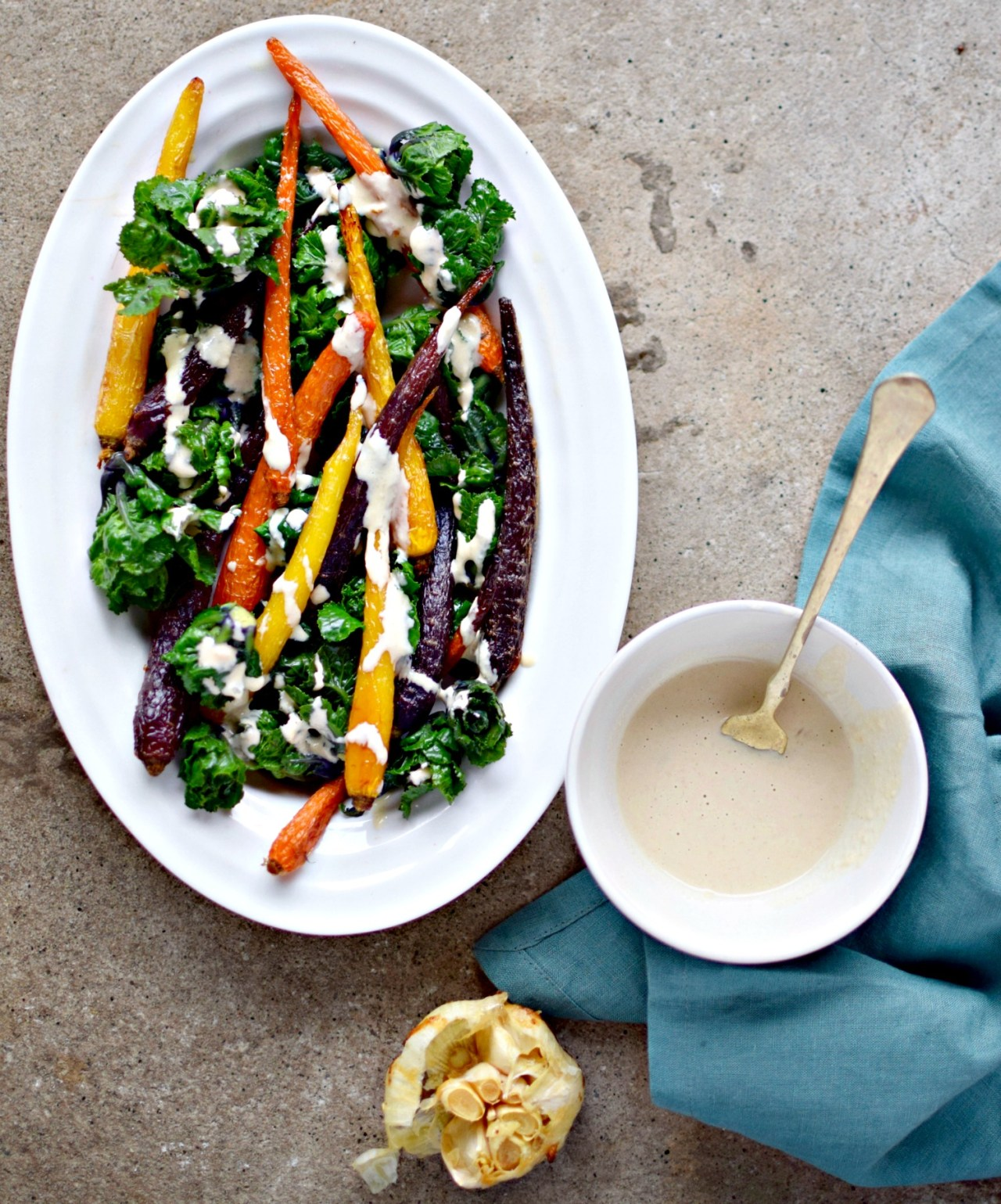 Whether you opt for fancy rainbow carrots or plump for everyday orange ones, painted in roasted garlic-tahini drizzle this dish is holiday-table ready.