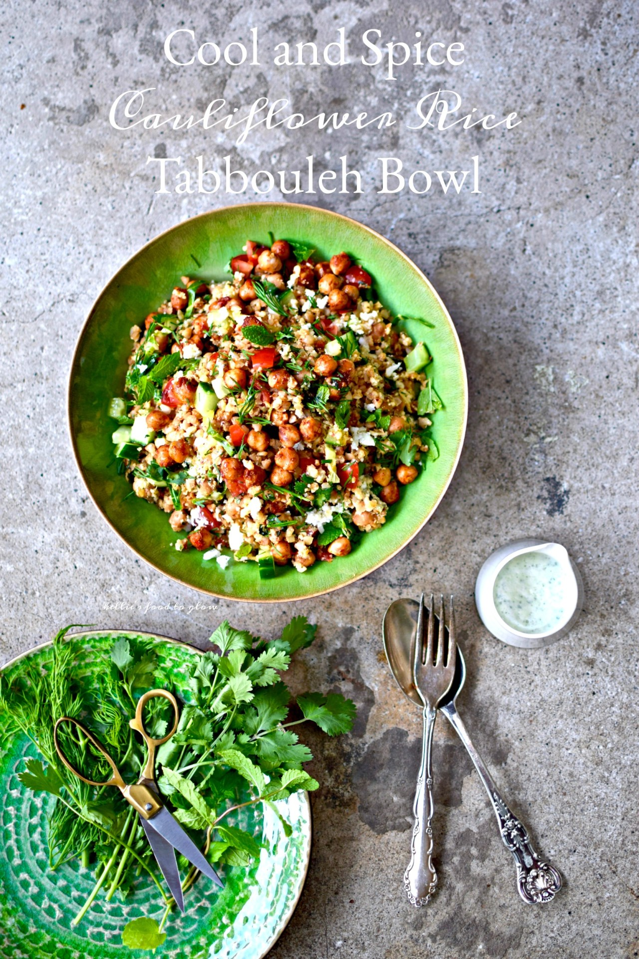 """Use your blender and one simple trick to zap whole cauliflower into perfect """"rice"""" for this throw together summer tabbouleh bowl. Add in harissa chickpeas, pre-cooked quinoa, herbs, veggies and a creamy feta and herb dressing for a cool but slightly spicy lunch or supper. Picnic-perfect and lunchbox-luscious,too."""