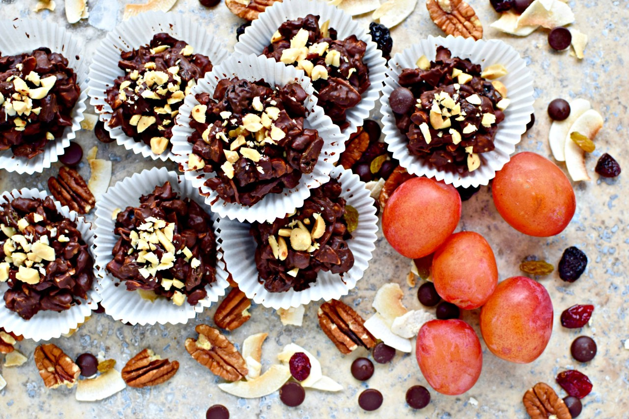 Four-ingredient chocolate, fruit and nut clusters are an easy, no-bake recipe for healthy, guilt-free snacking. Perfect with a cup of tea and in lunch boxes.