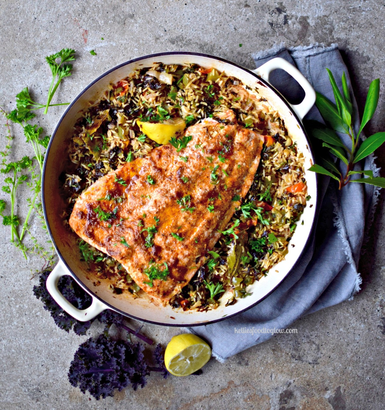 "Pearly-pink salmon kept juicy with a coating of creole spices and olive oil, cooked over vegetable-filled ""dirty"" brown rice. Healthy, family-friendly and surprisingly quick and easy for a midweek dinner. Leftovers are great cold in a wrap - lettuce or grain."