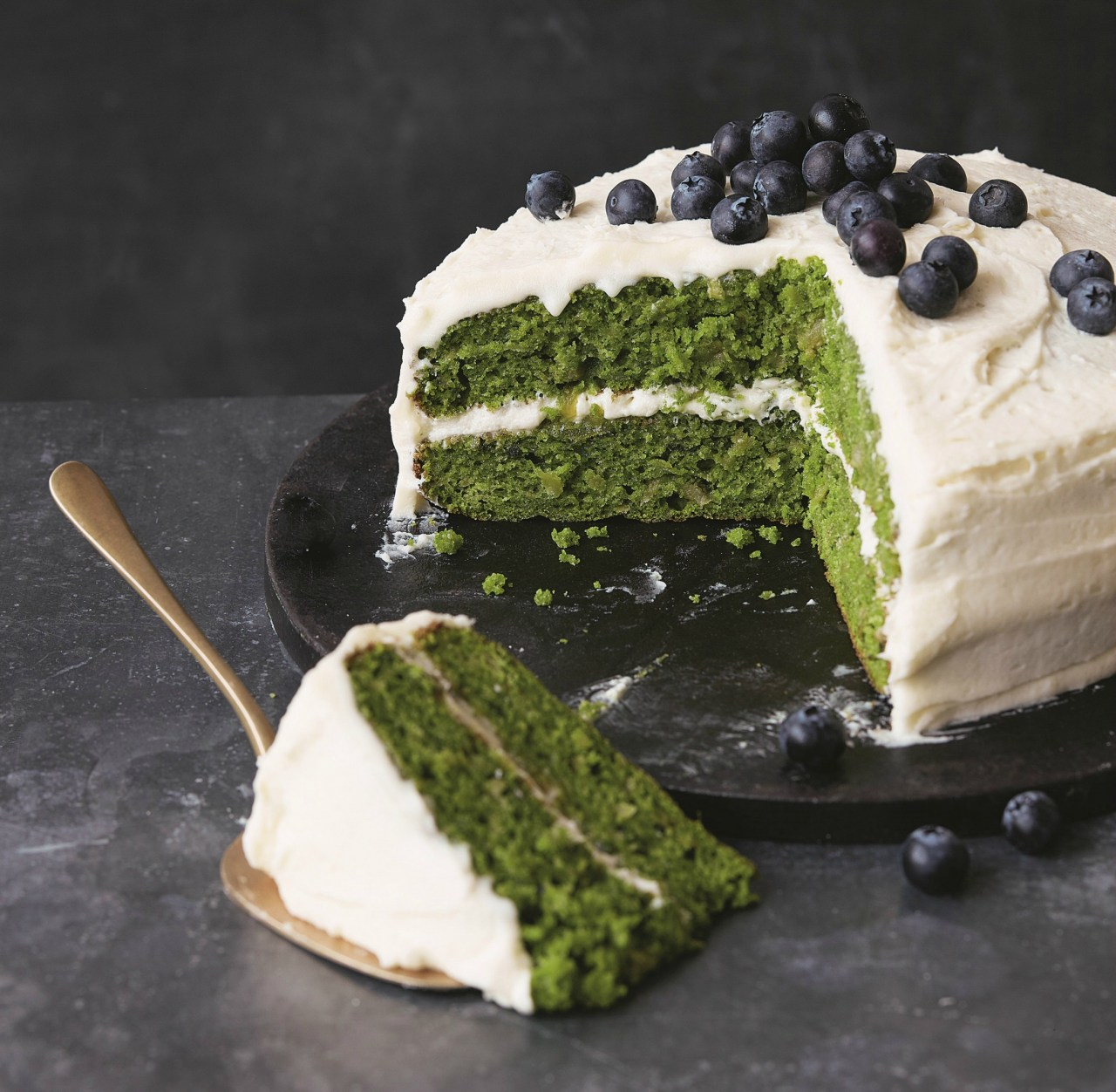 A delicate apple-flavoured sponge, topped with a zesty apple icing and, although there is quite a bit of kale, the flavour doesn't overpower the other ingredients. From the debut cookbook by Kate Hackworthy.