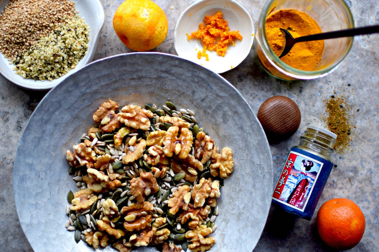 A kind of savory granola minus the oats, this turmeric and togarashi super seed mix is wonderful straight out of a jar, swirled into yogurt and sprinkled over all kinds of savory dishes. A super-easy paleo, sugar-free and vegan recipe. But don't hold that against it.