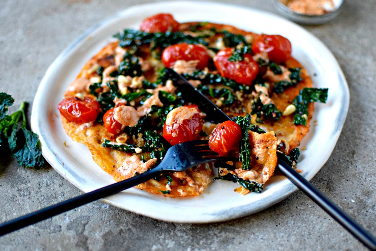 Weeknight pancake supper made healthy with kale, quinoa, tomatoes and tomato pesto. Naturally vegan and gluten-free. kelliesfoodtoglow.com