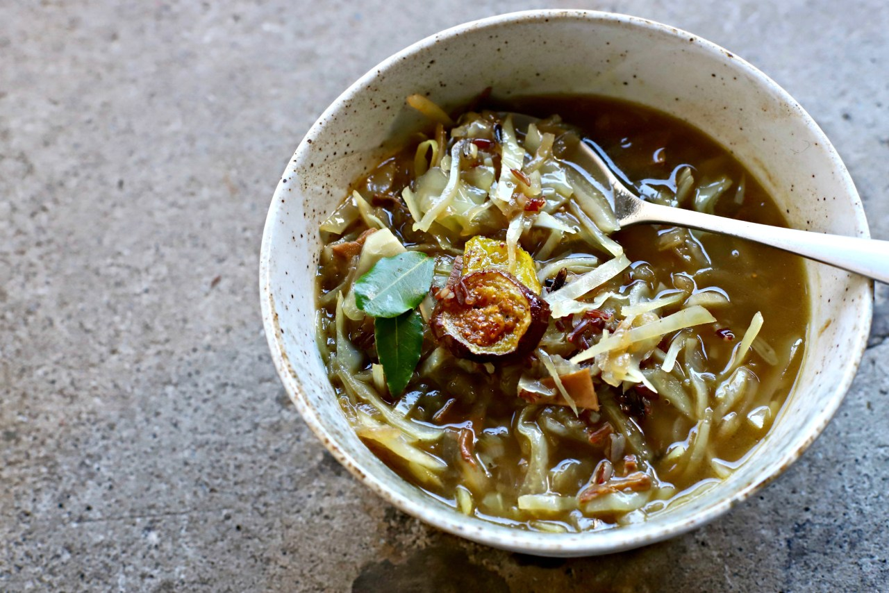 This humble cabbage, sweet onion and porcini mushroom soup is as simple, honest, and delicious as it gets. Served hot and slurpy with flecks of wild rice, it's the kind of soup that comforts and fortifies body and spirit. Fit this into your autumn and winter lunch or dinner repertoire for a nourishing, earthy boost.
