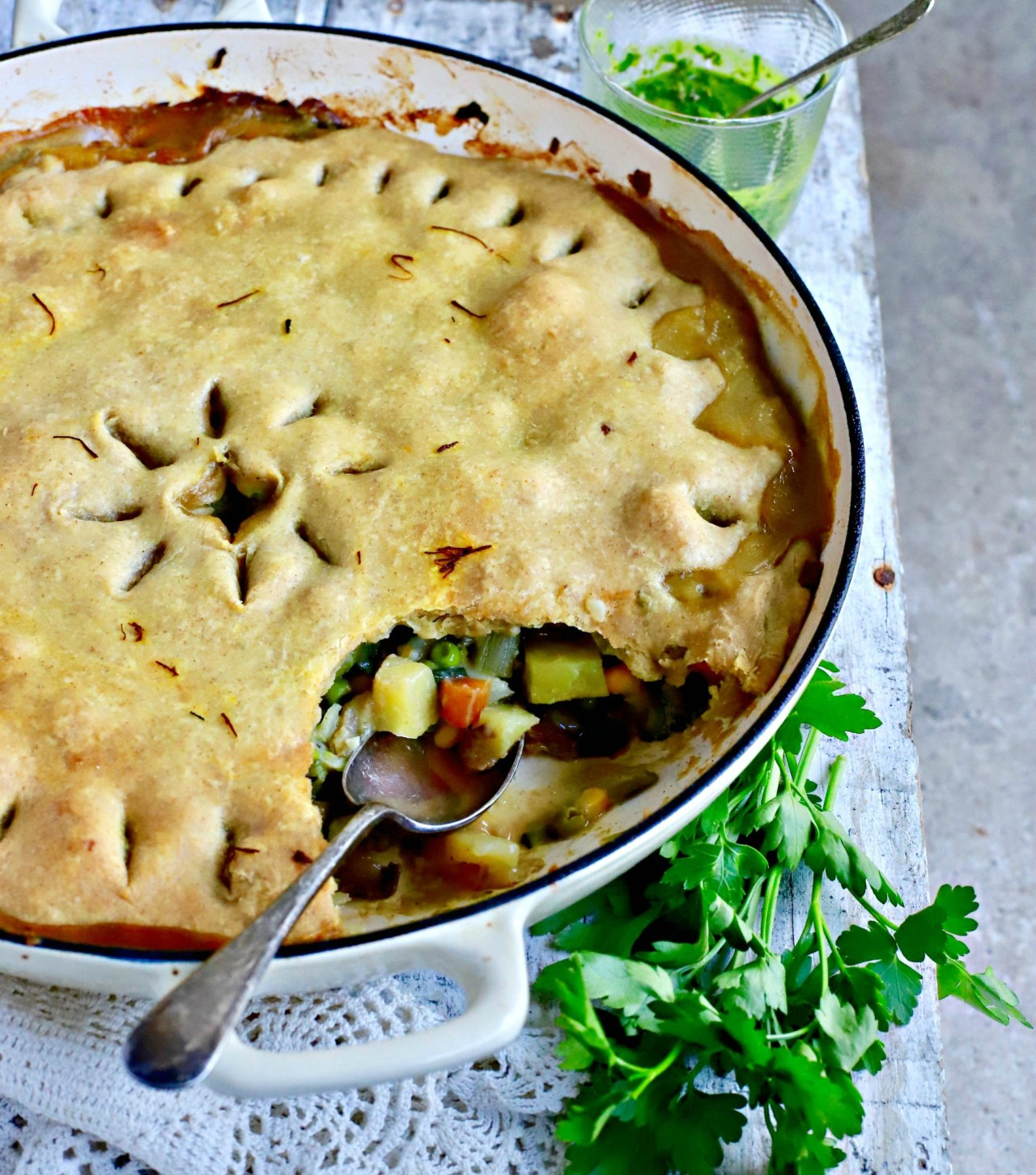 Vegetable pot pie gone a bit fancy with saffron, porcini mushrooms and an olive oil crust. This #vegan, weekend family #food #recipe will remind you of pot pies of yore, but without the saturated fat. #potpie #familyrecipe #vegetables #vegetarian #baking