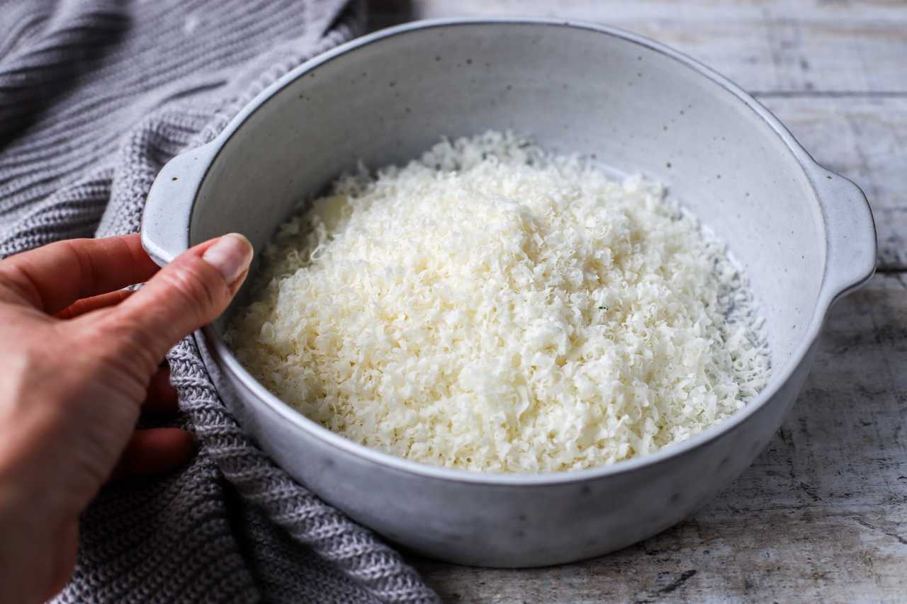 Freshly grated Parmigiano Reggiano cheese by kellie anderson kelliesfoodtoglow.com
