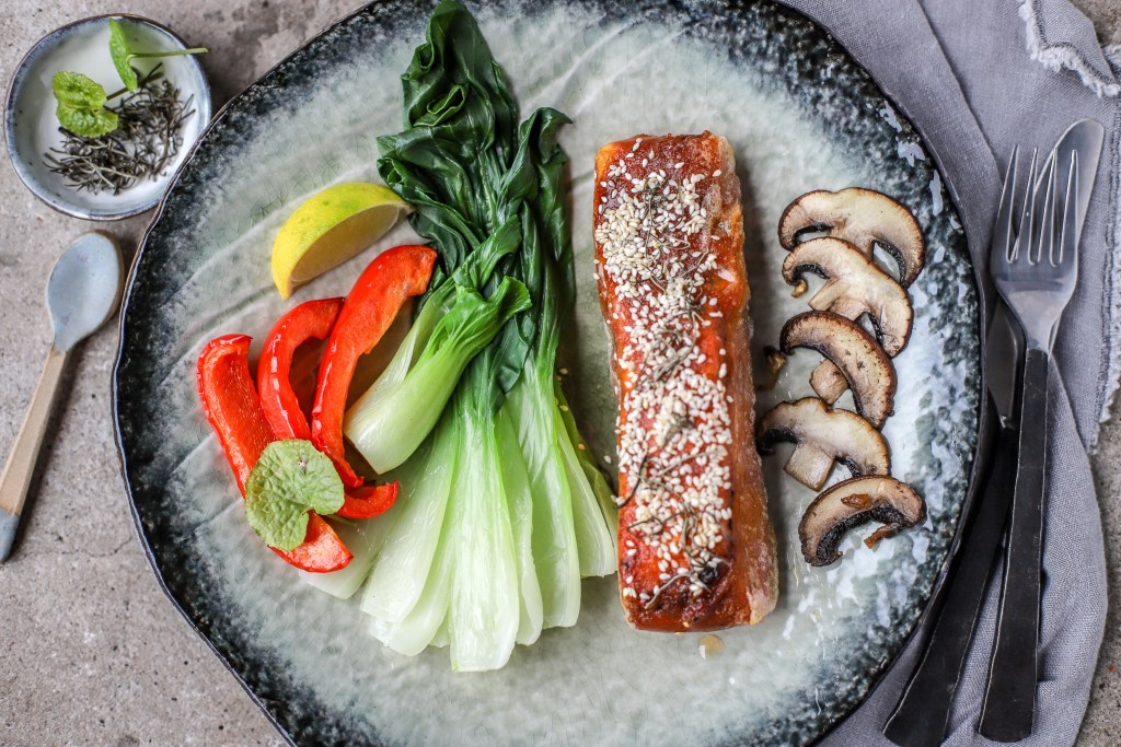 crispy Korean salmon plated with vegetables on a Japanese hand-thrown plate