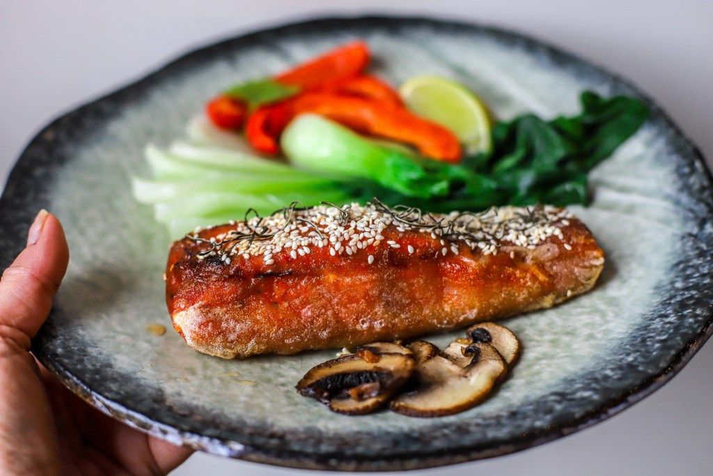 korean crispy salmon of handmade Japanese plate with vegetables