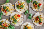 flatlay of soft tacos with vegetables on baking paper