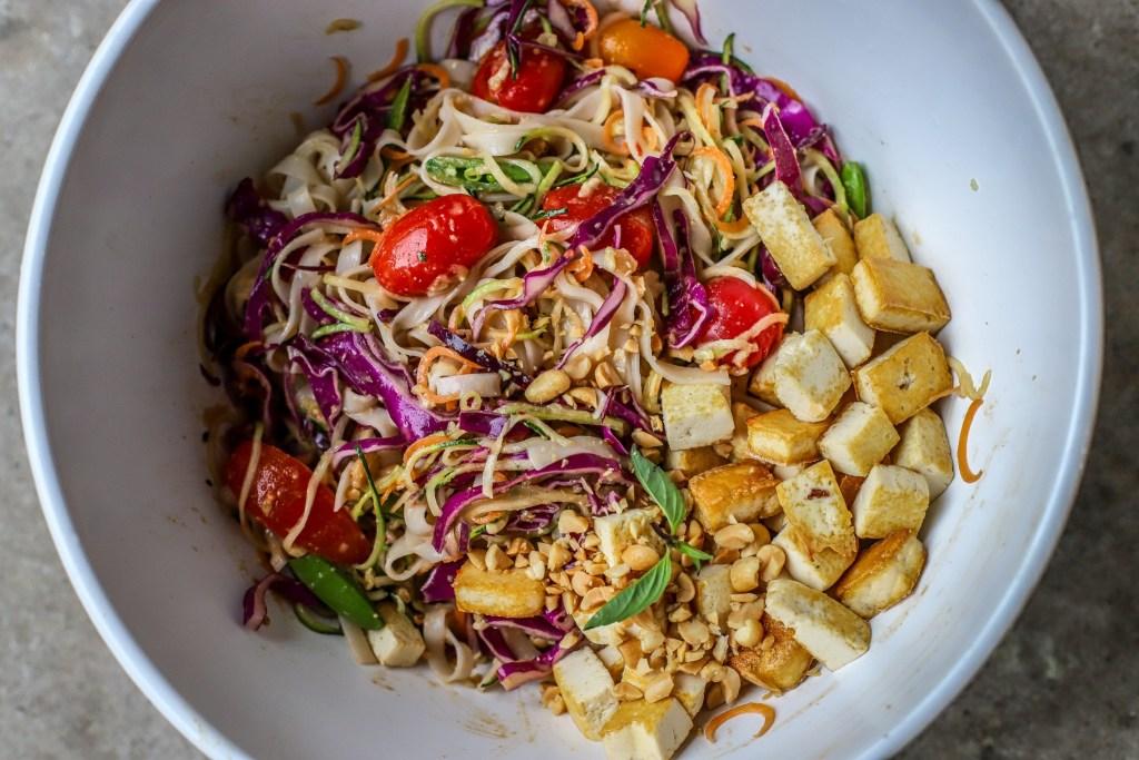 adding tofu to the thai salad