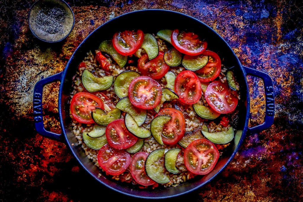 layer of tomato and eggplant on risotto