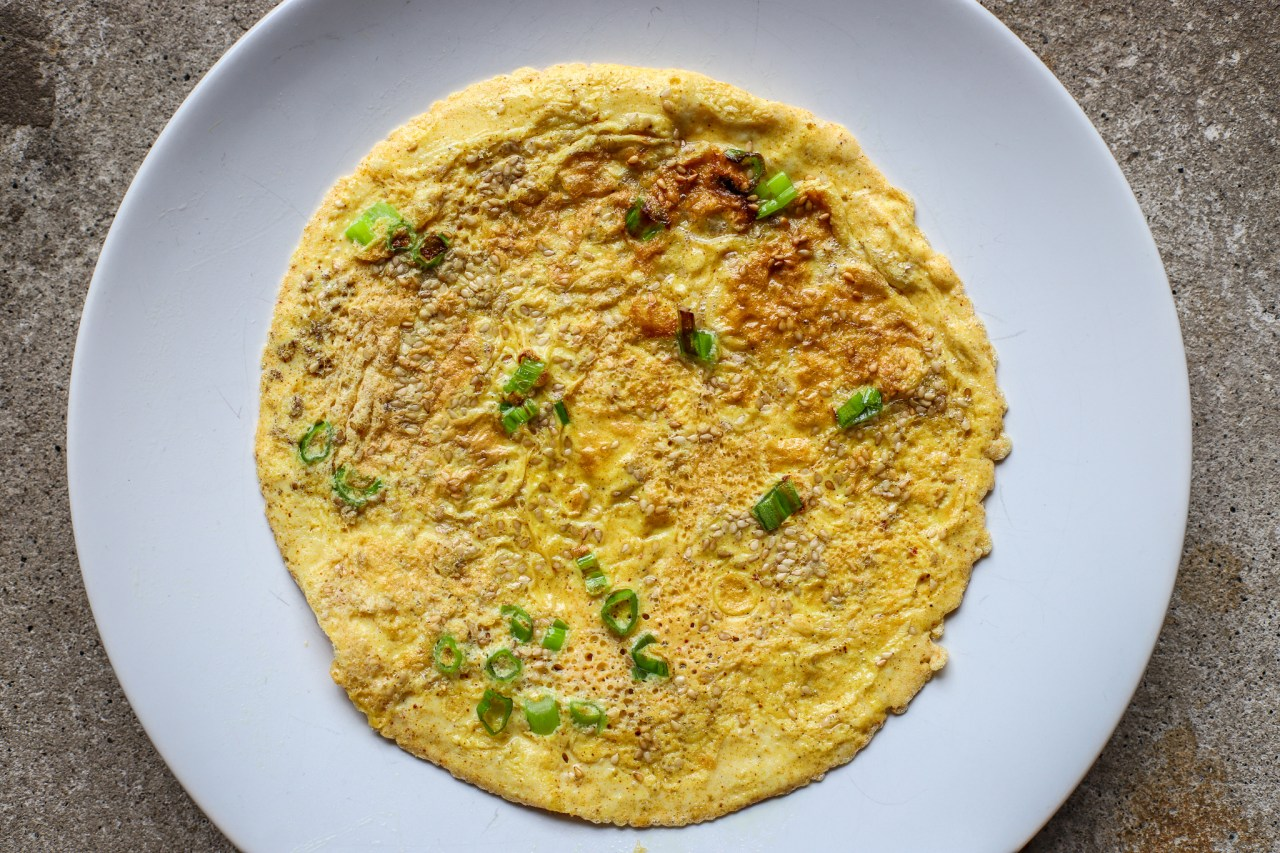 flat omelette on white plate