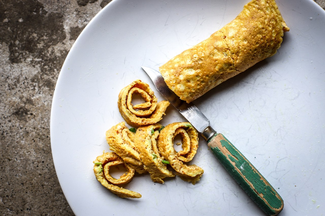 flat omelette cut into spirals with vintage green paring knife