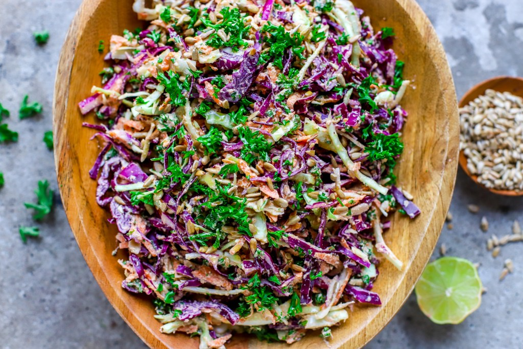 creamy sunflower-ranch coleslaw in wooden assymetrical bowl