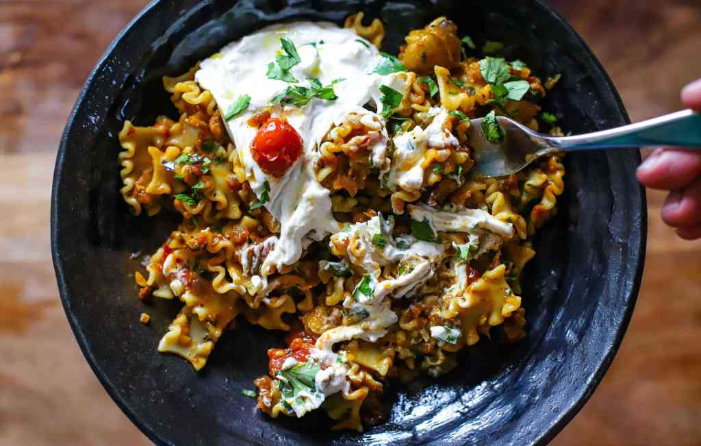 eating the Indian eggplant, pasta and cheese dish