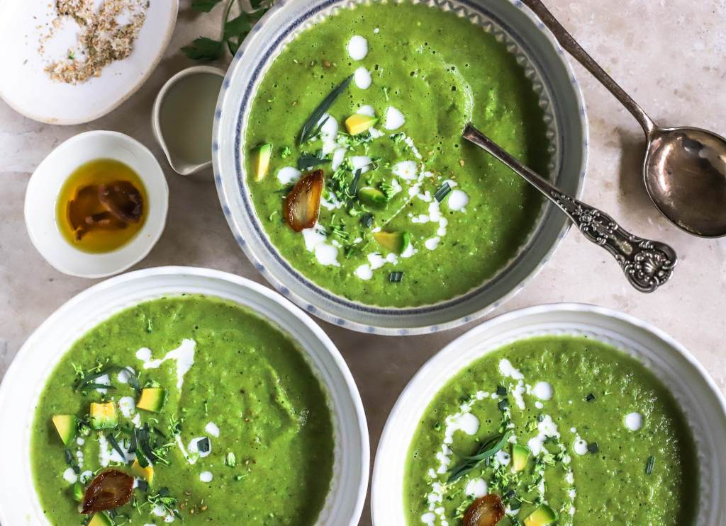 creamy green soup in bowls
