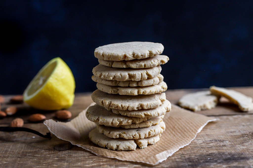 stack of buttery lemon cookies with ingredients