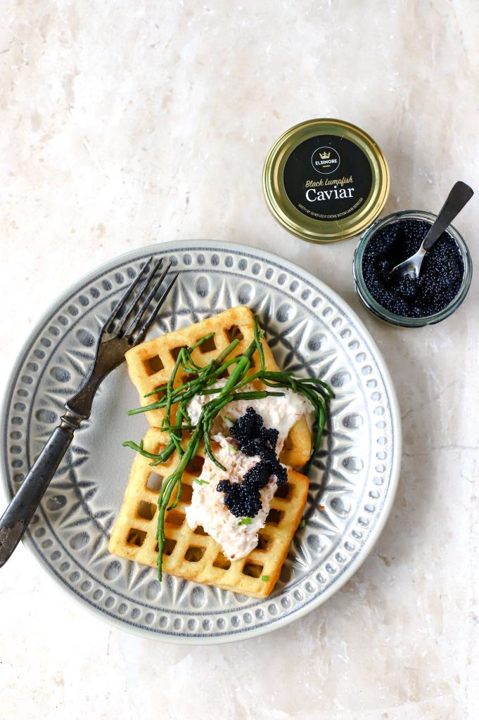 potato waffles with creamy sauce and caviar