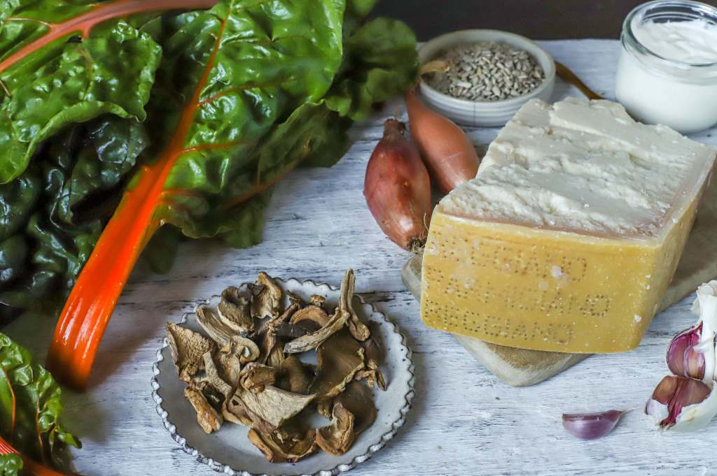 ingredients for chard and porcini mushroom gratin