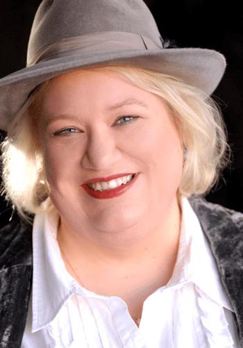 Photo of author Kelli Stanley in gray fedora