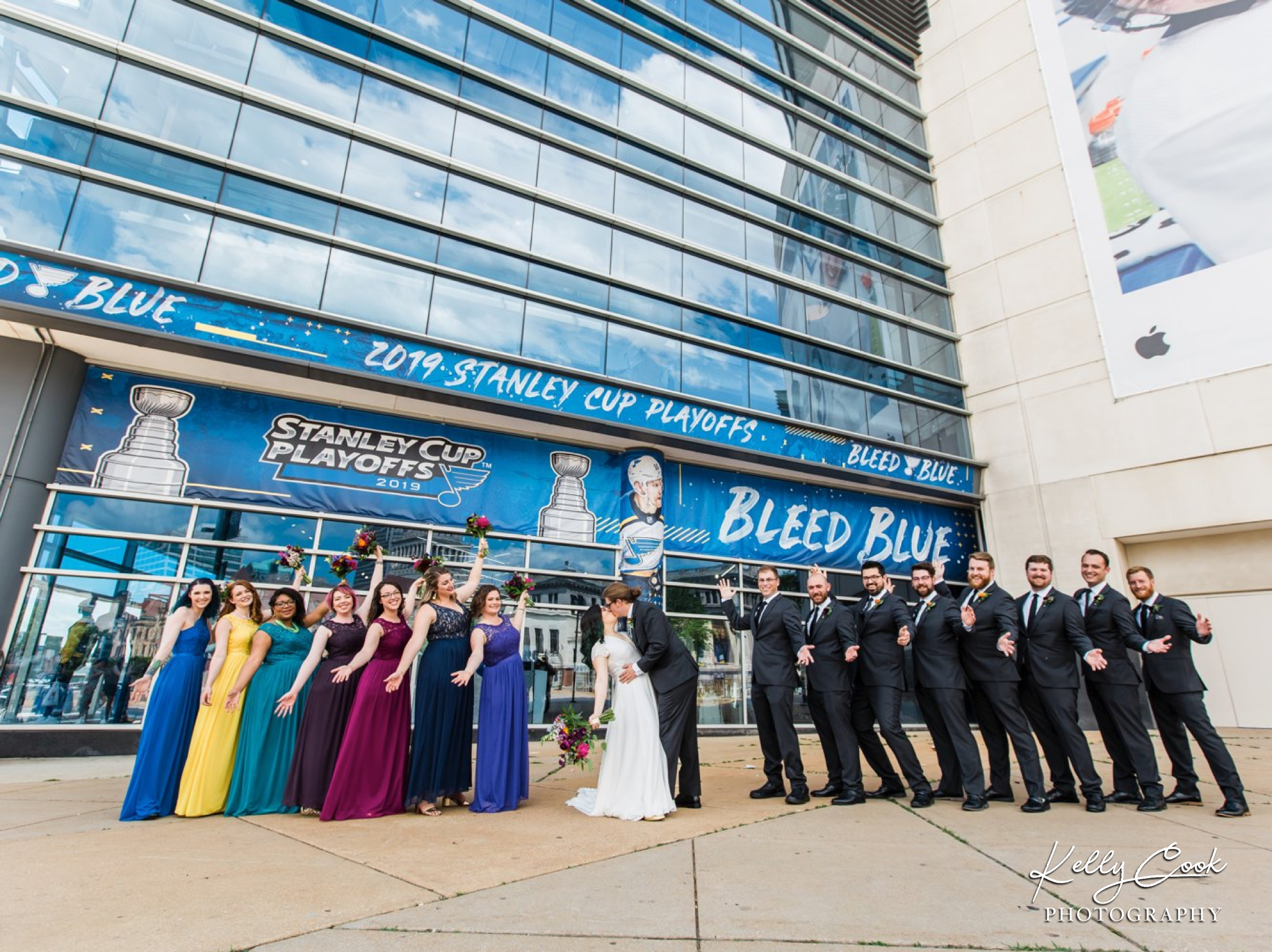 St. Louis Blues wedding photo of a wedding party cheering
