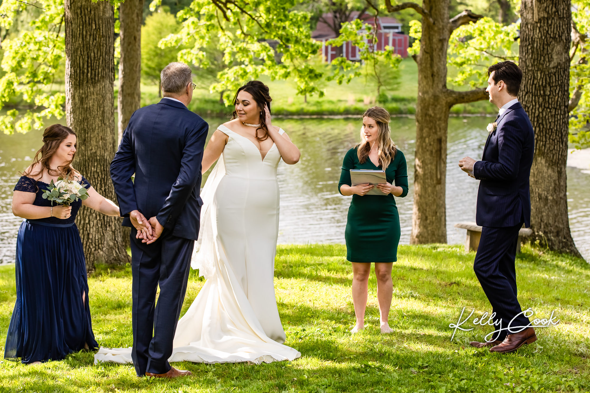 A bride and her father walking down the aisle for a backyard mini wedding