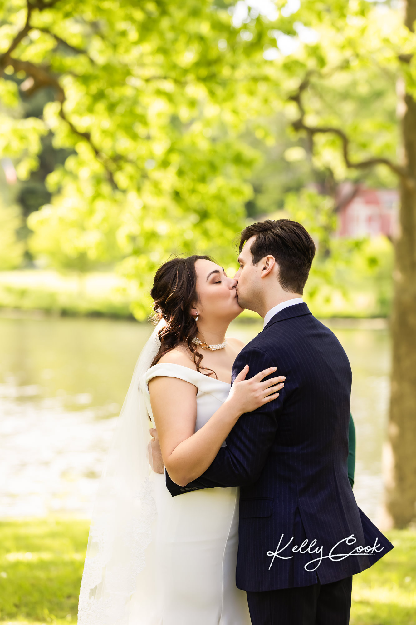 A couple's first kiss at their backyard micro wedding in St. Louis