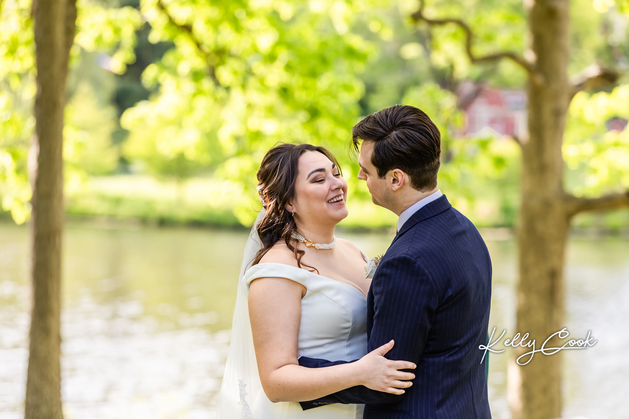 A couple laughing at their backyard micro wedding in St. Louis