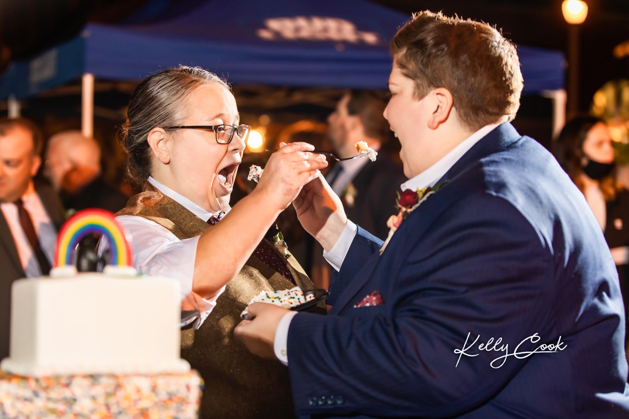 Brides cutting their wedding cake