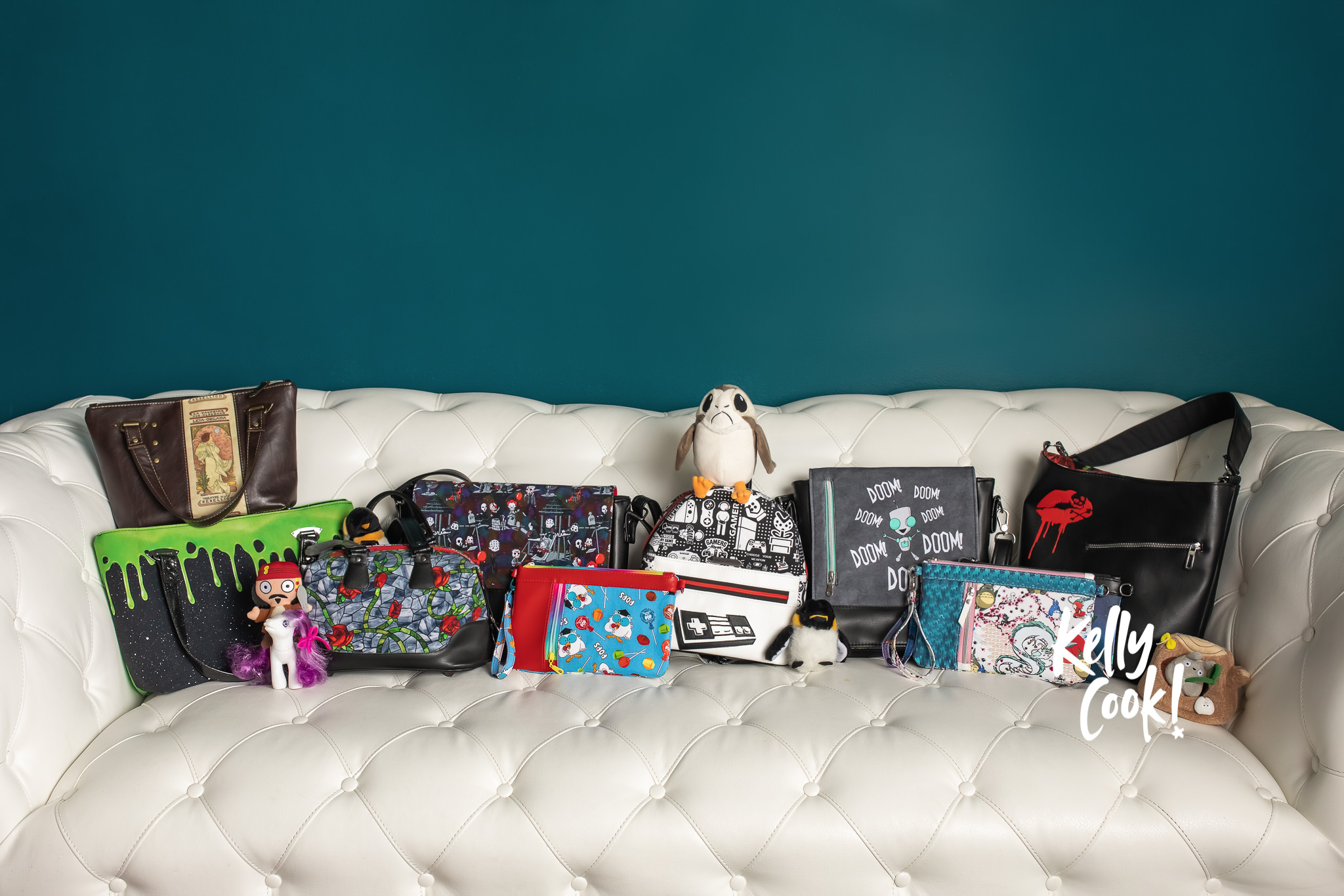 Sofa with geeky purses and bags lined up across it